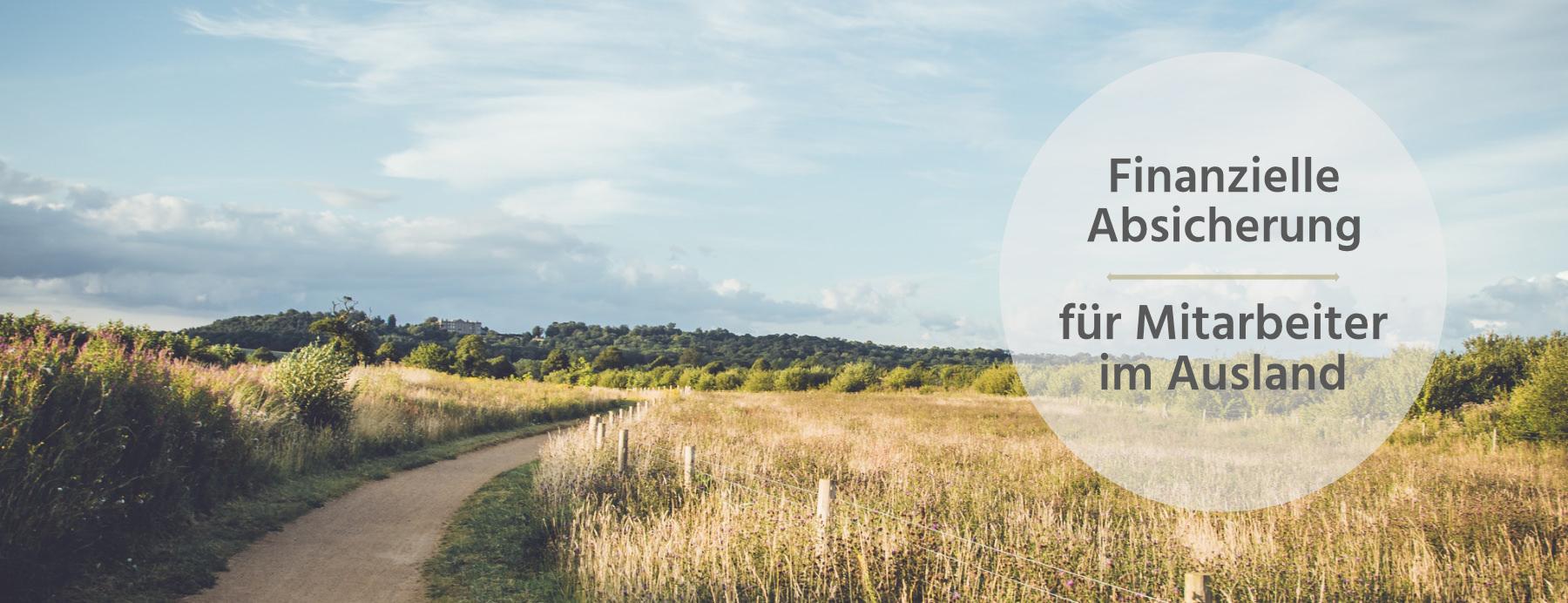 Landschaft Weg Text: Finazielle Absicherung für Mitareiter im Ausland